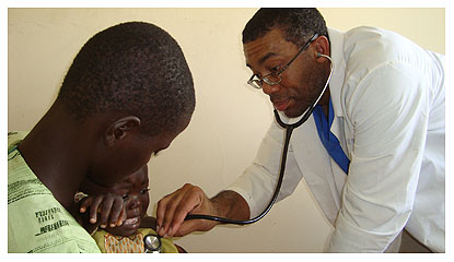 Doctor working with parent and child